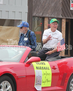 Dwight Morenz, right, and Jim Bruce, left, toss candy from a car during the Western Days parade. GRAPHIC-ADVOCATE PHOTO/ERIN SOMMERS