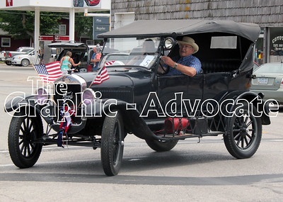 A man drives a vintage car during the Western Days parade in Lake City. GRAPHIC-ADVOCATE PHOTO/ERIN SOMMERS
