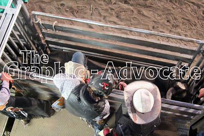 A bull rider climbs into the chute just before his ride at the Western Days Rodeo Saturday in Lake City. GRAPHIC-ADVOCATE PHOTO/ERIN SOMMERS