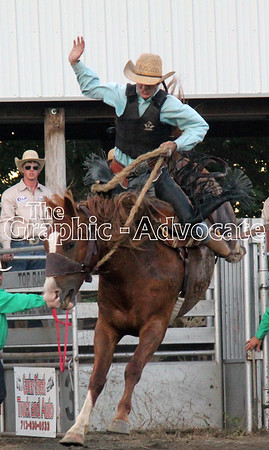 A bronco bucks while a rider tries to stay on during Saturday's Western Days Rodeo. GRAPHIC-ADVOCATE PHOTO/ERIN SOMMERS