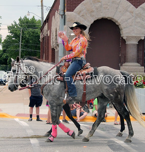 Riders wave to paradegoers Saturday in Lake City. GRAPHIC-ADVOCATE PHOTO/ERIN SOMMERS