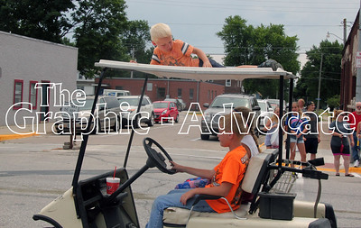 A boy rides on top of a golf cart during the Western Days parade Saturday. GRAPHIC-ADVOCATE PHOTO/ERIN SOMMERS
