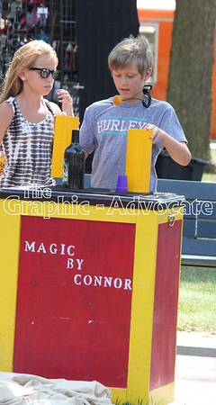 A young magician performs tricks on the Lake City square Saturday morning. GRAPHIC-ADVOCATE PHOTO/ERIN SOMMERS