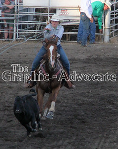 A cowgirl chases a calf during a roping event at the Western Days Rodeo in Lake City Saturday night. GRAPHIC-ADVOCATE PHOTO/ERIN SOMMERS