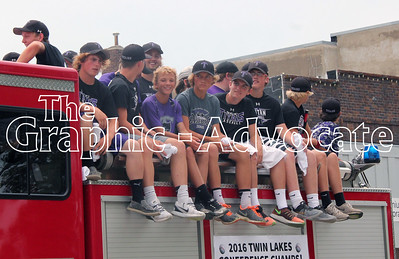 The South Central Calhoun High School baseball team rides a firetruck during the Western Days parade in Lake City Saturday. GRAPHIC-ADVOCATE PHOTO/ERIN SOMMERS