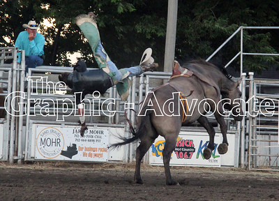 A rider flies off a bucking bronco during the Western Days Rodeo Saturday in Lake City. GRAPHIC-ADVOCATE PHOTO/ERIN SOMMERS