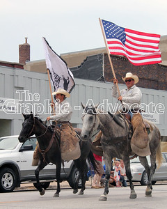 Rodeo representatives bring flags down Main Street in Lake City Saturday afternoon. GRAPHIC-ADVOCATE PHOTO/ERIN SOMMERS