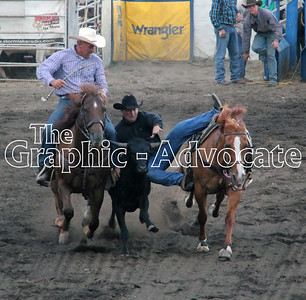 A cowboy jumps on to a steer during the steer wrestling event at Saturday's Western Days Rodeo in Lake City. GRAPHIC-ADVOCATE PHOTO/ERIN SOMMERS