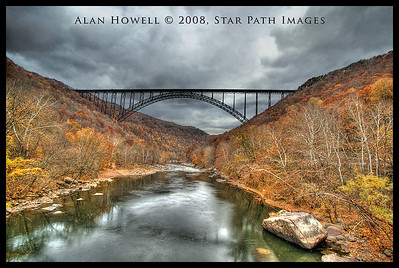 The largest steel arch bridge in the Western Hemisphere, the New River Gorge Bridge.   This is an HDR (high dynamic range) photo taken from the original lower bridge. This was a 7 photo stack, plus added enhancement to bring out details in the sky.