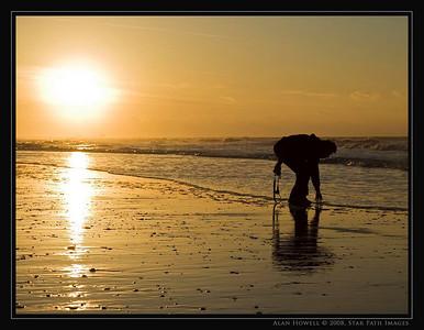 A beach explorer enjoys the sunrise and surf of Atlantic Beach NC.