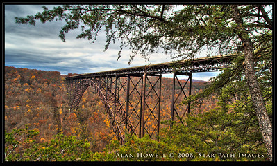 This is an HDR (high dynamic range) photo of the largest steel arch bridge in the Western Hemisphere, the New River Gorge Bridge.   This was an 8 photo stack, plus added enhancement to bring out details in the sky.
