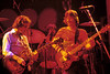 Bob Weir, Mickey Hart and Phil Lesh perfoming with the Grateful Dead at Oakland Auditorium on December 30, 1979.