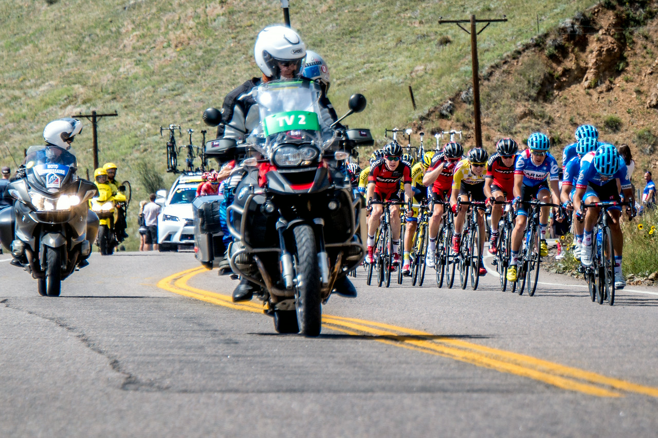 "August 25,<br /> <br /> This past week was the 4th year of the USA Pro Cycling Challenge here in Colorado.  From Monday to Sunday these ultra athlete cyclists ride with the support of a team and compete in this incredibly difficult race. This year there were ten host cities across Colorado.  The 550 mile course had a total elevation gain of 40,000 feet over seven days with the highest elevation at 11,542 feet on Hoosier Pass.  There was a mountain top finish at Monarch Pass this year.  These riders experienced 3 seasons of weather over the week.  It was fun to follow the race throughout the week on television.  I cannot imagine the training and discipline that goes into competing at this level.  <br /> <br /> This image captures the peloton, the main group of riders that ride as a group almost like birds in formation.  These riders save energy by riding close which is referred to as drafting near or  behind other riders. The reduction in air resistance is impressive; in the middle of a peloton it can be as much as 40%.  Thus this group shares in the work and saves energy as well.  It is fun to see who breaks from the peloton to move ahead.  <br /> <br /> It was good to have the distraction of this exciting event this past week.  It was good for the host cities as well as the state of Colorado.  I simply enjoyed the thrill of watching professional cyclists from over 20 countries compete with dignity and respect  for their teams, their fellow racers, and for themselves, <br />  <br /> ""Bicycles have no walls.""~ Paul Cornish<br /> <br /> Peace."