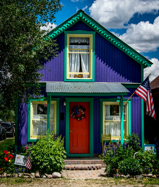 "July 17,<br /> <br /> Houses in small mountain towns can have a personality all their own.  This colorful and well-maintained gem caught my eye recently.  Everything about this home  has had an eye for detail. It took work to get this home looking so colorfully attractive.  Many thanks to the owners of this home for giving such a visual gift to all who pass by.<br /> <br /> Walking around small mountain towns is an enjoyable pastime.  One never knows what is around the corner. This neat home came into view and just struck my senses.  Everything about it is passionate and on the fun side; yet it is very tastefully done.  I would enjoy knowing the owners. Just imagine the detail on the inside.  I am grateful for their passion.<br /> ""You make a living by what you get. You make a life by what you give.""~Winston Churchill<br /> <br /> Peace."