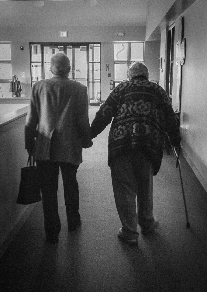 March 7,<br /> <br /> Have you noticed older couples whom you admire and see as an example for living and loving?  Some of us are fortunate to have parents still setting that example for us.   It is touching for it is a blessing in itself to be able to reach the later years together.  In our family we are grateful for my husband's parents as a shining example.  <br /> <br /> But there is another example I touch on here.  I have been yearning to capture this image for months so I did not resist using my phone in a pinch.  Every week it is a treat to see Jean and Ben.  Sundays, if feeling well, they can be found in the second row of our sanctuary.  Thursday mornings he drives her to our church for our group and waits for her in the library until  our last conversation is complete.  Jean is such a dynamic and important member of our group and her insight is valued by each one of us. They then make their way to go home.  I marvel at their strength, courage, and commitment. They are a beautiful example of love.  I am so grateful to know and love this precious couple. They bless us all at Evergreen Lutheran Church.<br /> <br /> Peace.