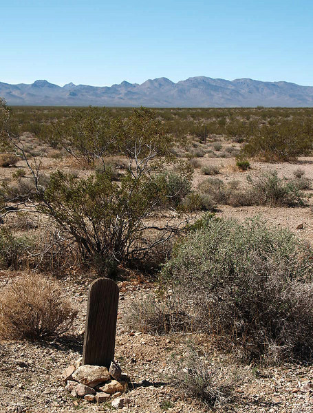 Lonely grave.  Bullfrog Mine Cemetery near Rhyolite (ghost town) Nevada.  2007.