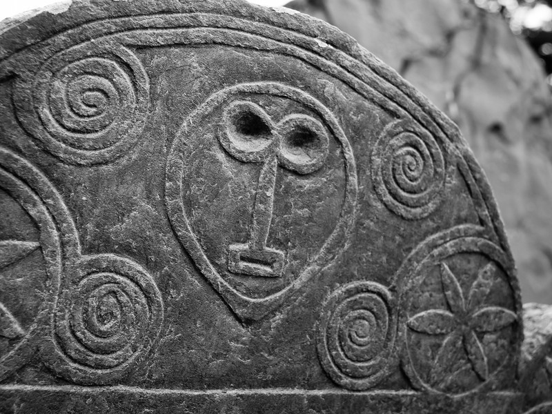 Old Hill Burying Ground in Concord, MA.  The light wasn't ideal to bring up the carving details, but I've always loved this type of stylized face.