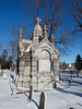 Elaborate crypt in Valley Street Cemetery, Manchester NH.  It's fenced off due to the high amount of vandalism this cemetery receives.<br /> Dec 2009