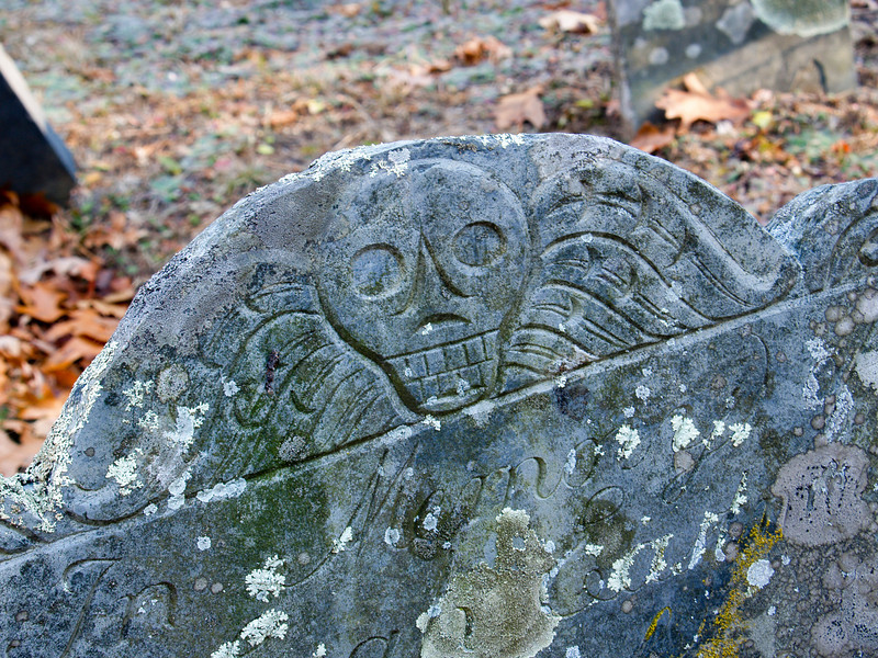 Skull detail on a marker at Ye Olde Cemetery, Danville NH.  Many, many other stones were worn to unreadability, but this one wasn't.<br /> Nov 2009