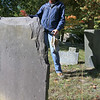 Shirley Cemetery Commissioner Barbara Yocum talks about a gravestone that has been misplaced with the Brown family graves in the Shirley Center graveyard.  SENTINEL & ENTERPRISE/JOHN LOVE