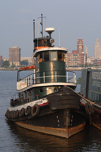 Tug Jupiter (1902)  Length: 101 ft. overall Beam: 22 ft. Draft: 9 ft. 4 in. Tonnage:147 gross tons  The tug Jupiter was built in the Philadelphia shipyard of Neafie and Levy in 1902. Built out of  charcoal iron, she was made for the Standard Oil Company and christened Sacony #14. From 1902 to 1939, she was in service in New York, towing Standard Oil fuel ships and barges. In 1939, she was purchased by Independent Pier Company to work in Philadelphia. After World War II, she was converted from a steam tug to diesel, using the salvaged engine from a decommissioned Landing Ship Tank (LST).  In 1999, the Jupiter was purchased by Penn's Landing and turned over to the care of the Philadelphia Ship Preservation Guild. Currently, she takes part in educational programs, festivals, and boat parades. Jupiter is also used as a functioning tug, moving the Ship Guild's other vessels. The operation and maintenance is performed by a volunteer group of active and retired tugboat professionals and enthusiasts.  Information came from the following site - http://www.gazela.org/ships/jupiter/jupiter.htm