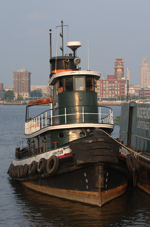 "Tug Jupiter (1902)<br /> <br /> Length: 101 ft. overall<br /> Beam: 22 ft.<br /> Draft: 9 ft. 4 in.<br /> Tonnage:147 gross tons<br /> <br /> The tug Jupiter was built in the Philadelphia shipyard of Neafie and Levy in 1902. Built out of  charcoal iron, she was made for the Standard Oil Company and christened Sacony #14. From 1902 to 1939, she was in service in New York, towing Standard Oil fuel ships and barges. In 1939, she was purchased by Independent Pier Company to work in Philadelphia. After World War II, she was converted from a steam tug to diesel, using the salvaged engine from a decommissioned Landing Ship Tank (LST). <br /> In 1999, the Jupiter was purchased by Penn's Landing and turned over to the care of the Philadelphia Ship Preservation Guild.<br /> Currently, she takes part in educational programs, festivals, and boat parades. Jupiter is also used as a functioning tug, moving the Ship Guild's other vessels. The operation and maintenance is performed by a volunteer group of active and retired tugboat professionals and enthusiasts.<br /> <br /> Information came from the following site - <a href=""http://www.gazela.org/ships/jupiter/jupiter.htm"">http://www.gazela.org/ships/jupiter/jupiter.htm</a>"