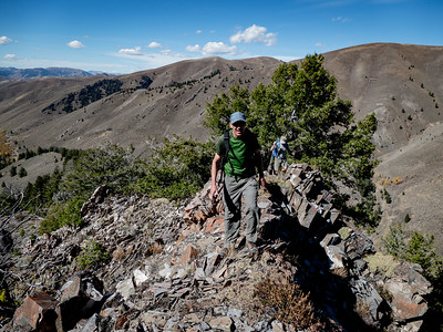 We crest a rocky section of the ridge while the East Fork road is visible back to the west.