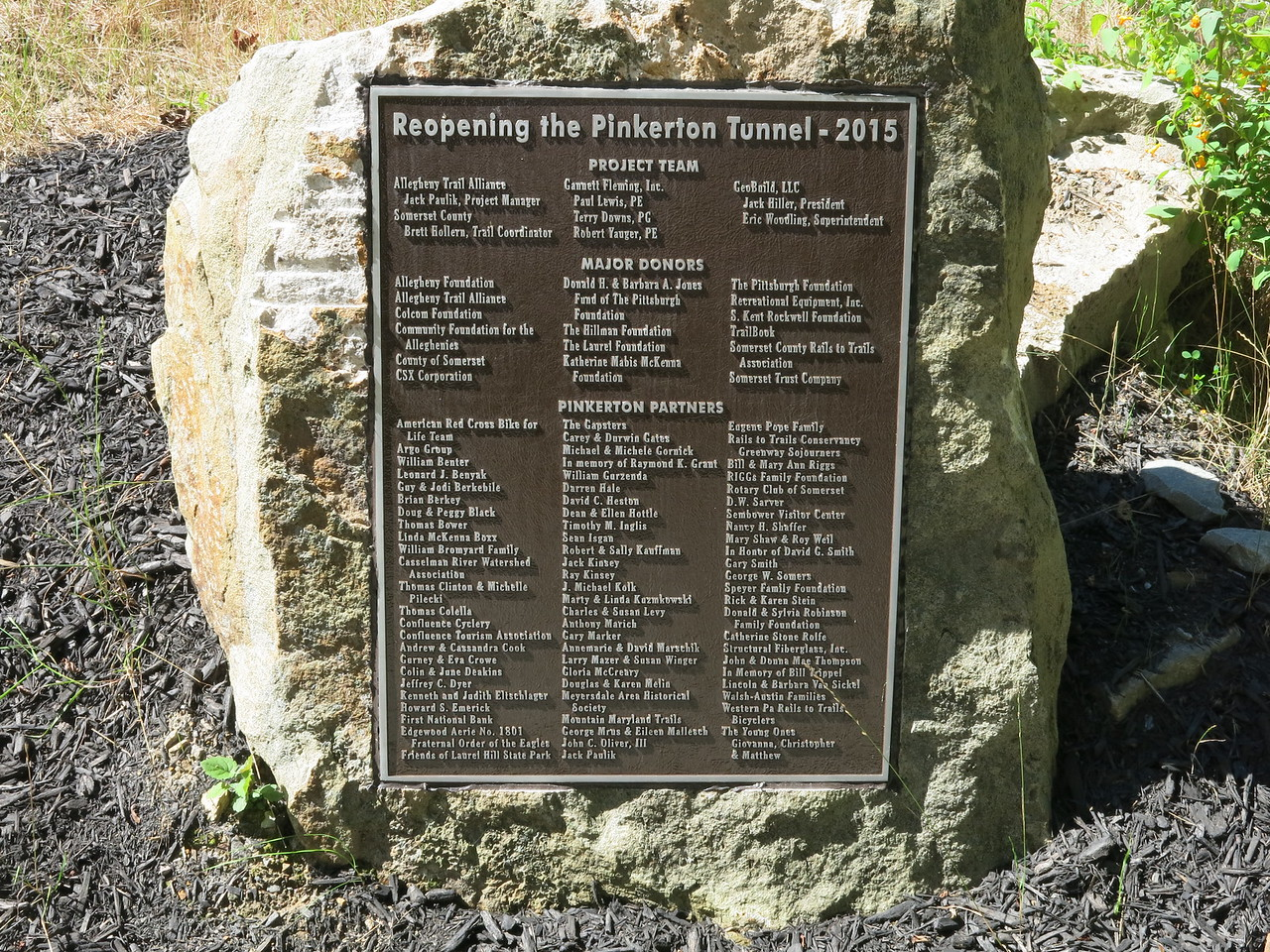 The plaque at the east portal of the tunnel commemorating the rebuilding of the tunnel in 2015