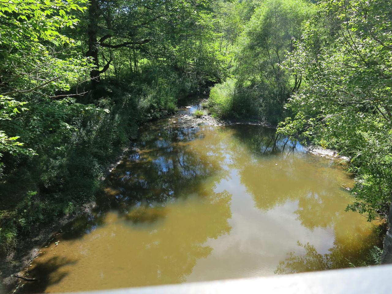 Lazy creek beneath the bridge