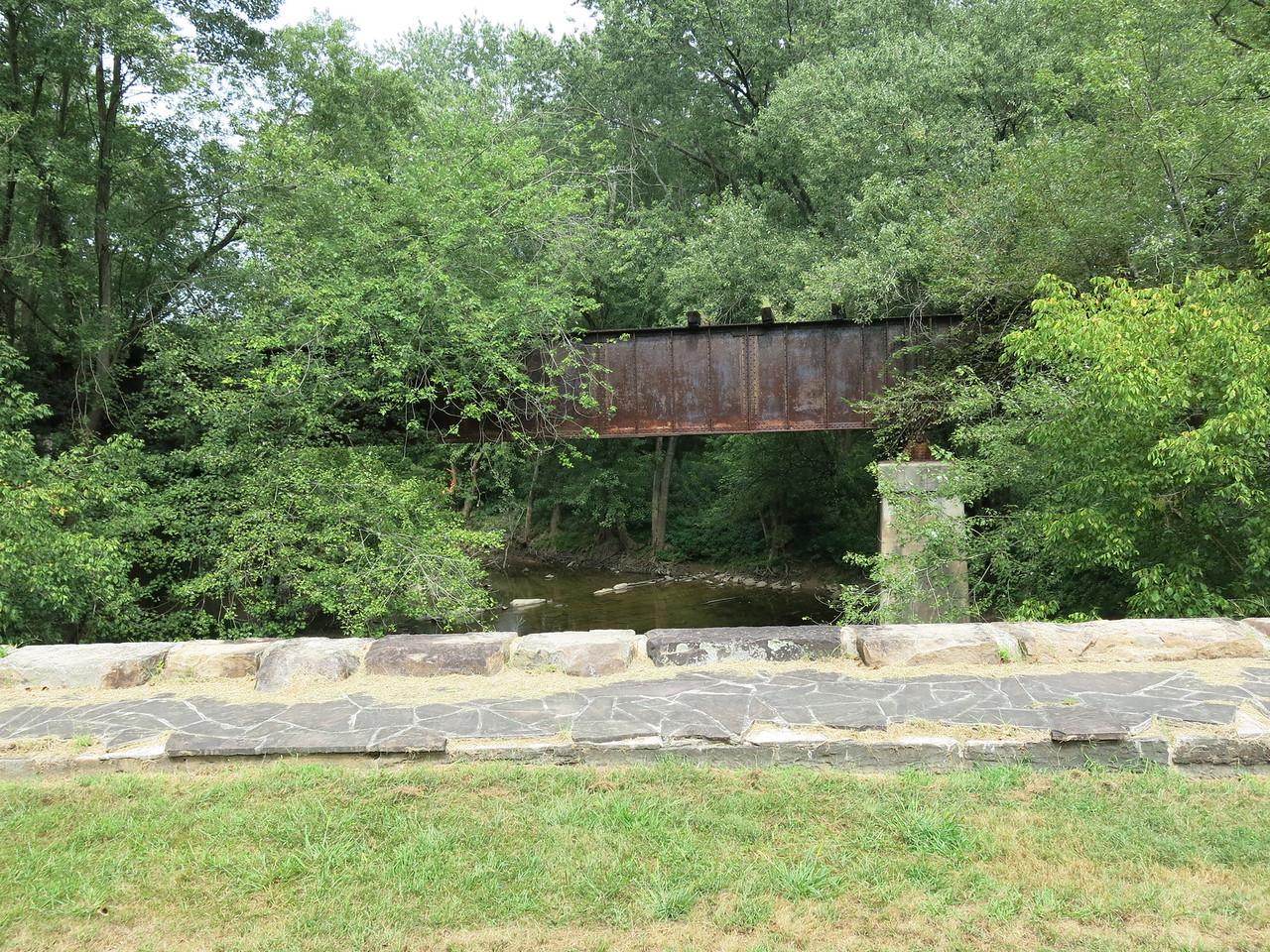 An abandoned Western Maryland Railroad bridge sits next to Town Creek Aqueduct