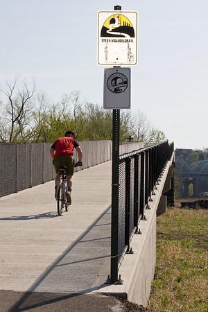Cyclist climbs ramp on McKeesport side of Riverton Bridge.  April 2010