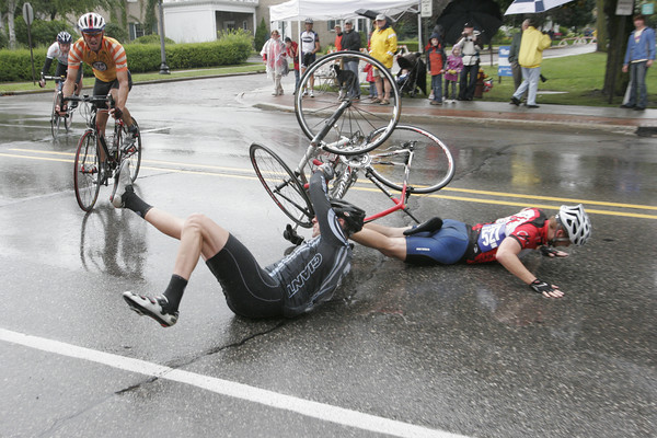 """Record-Eagle/Douglas Tesner<br /> Racers come off the turn at the corner of Sixth and Union Street in downtown Traverse City during the 2009 Cherry Roubaix bike race. Won 3rd place in the """"Sports Picture"""" category of the 2010 Michigan Press Association Better Newspapers Contest."""