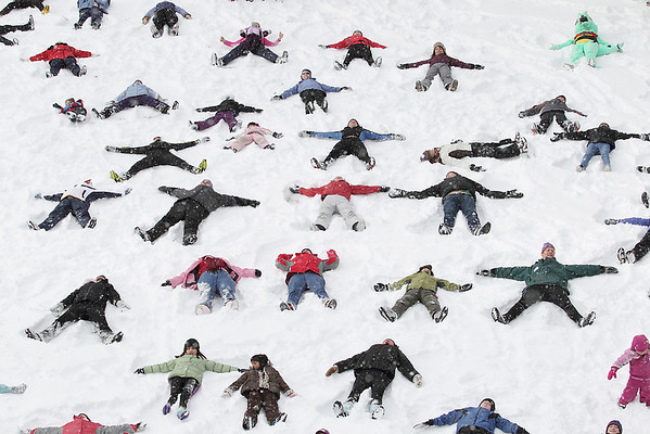 Record-Eagle/Keith King<br /> Participants in Winter Trails Day gather to make snow angels at Timber Ridge Resort.