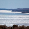 Record-Eagle/Jan-Michael Stump<br /> Ice covers Grand Traverse Bay's West Arm on Monday afternoon, March 2, 2009, looking north from Wayne Hill.