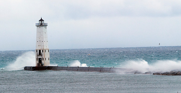 Record-Eagle/Douglas Tesner<br /> Wind and waves pound the Frankfort North Light in Frankfort.
