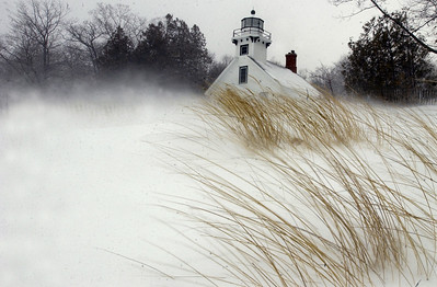 Record-Eagle/Tyler Sipe Blowing snow whips up dune grass near the Old Mission Lighthouse.