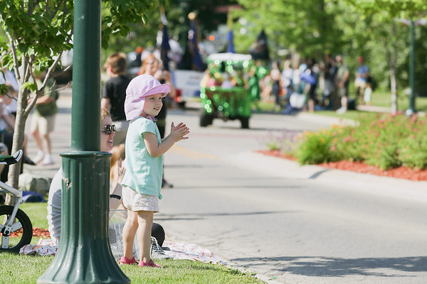 Record-Eagle/Keith King<br /> Evelyn Bourion, 3, of Kingsley, with her mother Jennifer Bourion, watches a parade as it travels through Kingsley during Kingsley Heritage Days.