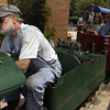 Train engineer Don Frost operates the steam train 'Spirit of Traverse City' through the Clinch Park Zoo Wednesday afternoon.