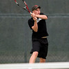Record-Eagle/Jan-Michael Stump<br /> Elk Rapids' Donnie Fedrigon returns a serve during Friday's no.1 singles final against Harbor Springs' Sam Dart in the Lake Michigan Conference championships Friday at Traverse City Central.