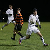 Record-Eagle/Keith King<br /> Traverse City Christian's Michael Weber, at right, looks to control the ball against Elk Rapids Thursday, October 21, 2010 in Elk Rapids.
