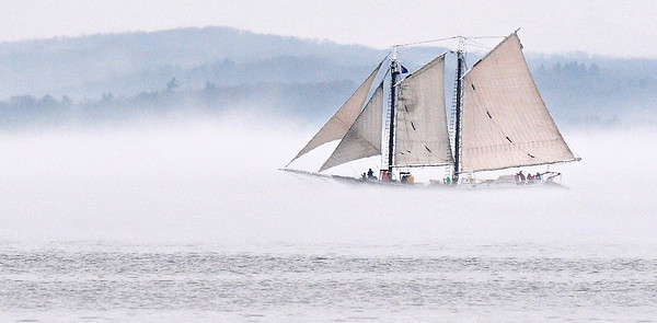 Record-Eagle/Nathan Payne<br /> The tall ship Manitou passes through the edge of a fog bank on the southwest edge of West Bay. The 114-foot-long schooner spent part of Monday afternoon cruising laps on the bay while warm winds pushed fog across the still-frigid water.
