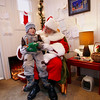Record-Eagle/Keith King<br /> <br /> Santa Claus sits with Will Sutton, 3, of Traverse City, Saturday, December 24, 2011 in downtown Traverse City and asks him what he would like for Christmas.