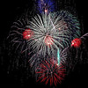 Record-Eagle/Jan-Michael Stump<br /> Fourth of July fireworks explode over West Grand Traverse Bay on Monday night.