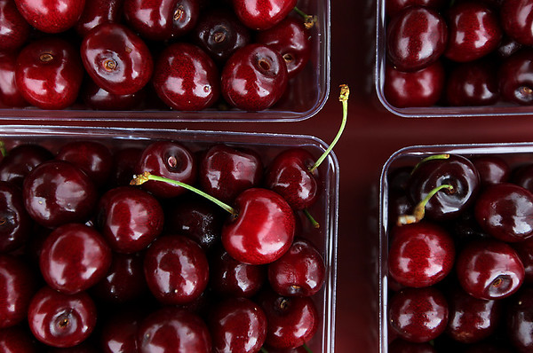 Record-Eagle/Keith King<br /> Cherries from Edmondson Orchards were for sale near the Open Space on Saturday during the opening day of the National Cherry Festival.