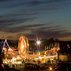 Record-Eagle/Jan-Michael Stump<br /> The sun sets over the National Cherry Festival's midway.