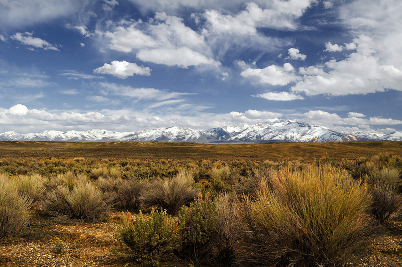 Range Front: The Ruby Mountains are thrust high above the basin from extensional block faulting and are part of a sea of endless mountain ranges and basins that stretch across the Great Basin, Ruby Valley, NV