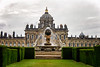 A fountain with Castle Howard in the background.