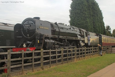Oliver Cromwell waits for the passenger train to depart before running through to pick up her next duty