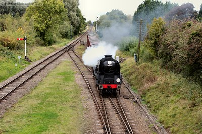 A blast on the whistle from 34053 as she approaches the station