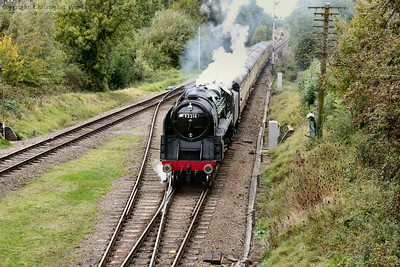 The 9F blows steam as she slows for the Quorn stop